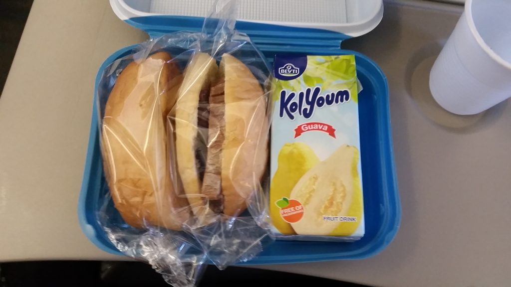 In flight snack on Nile Air. A Beef sandwich. A Vegetable sandwich. and a Guava drink box. (Kol Youm juice)