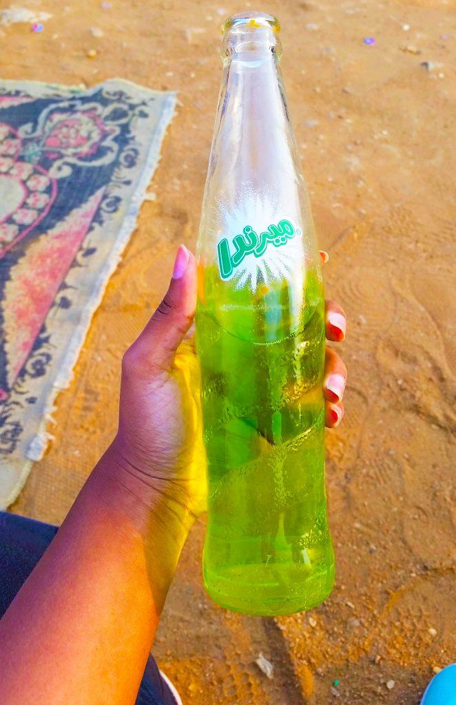 Green Apple Mirinda Soda written in Arabic