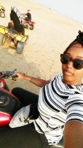 Black female traveler 4-wheeling in Cairo, Egypt