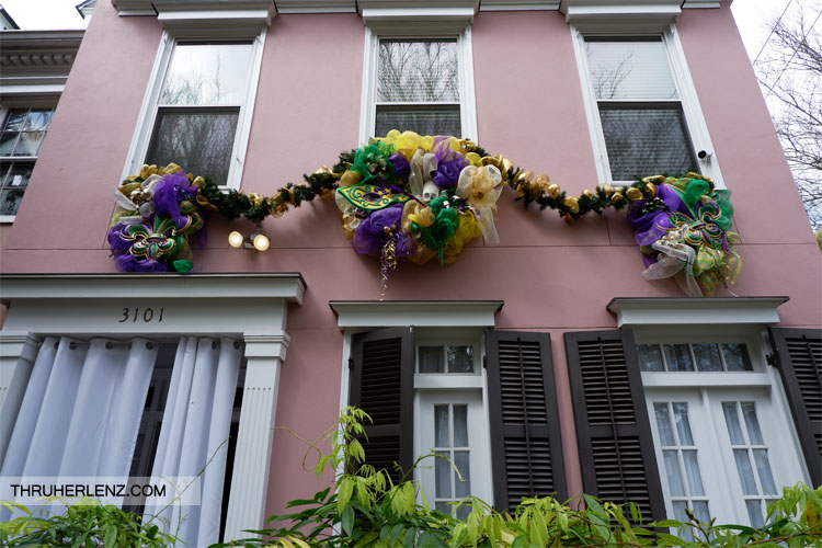 Pink Home in the Garden District decorated with Mardi Gras garland
