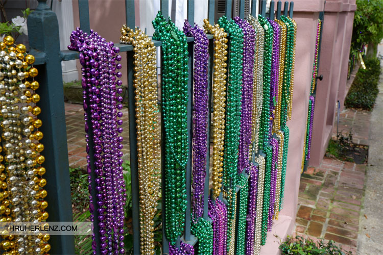 Beads along the fence of Garden District home for Mardi Gras celebration