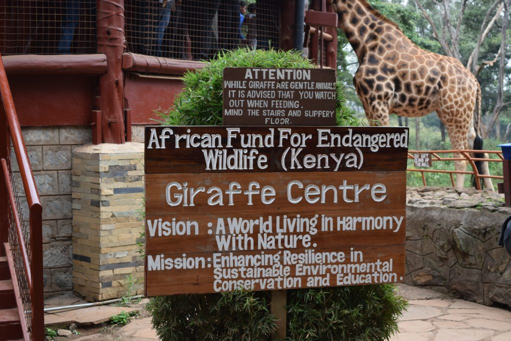 Sign at the Giraffe Centre with the Vision and mission statement.