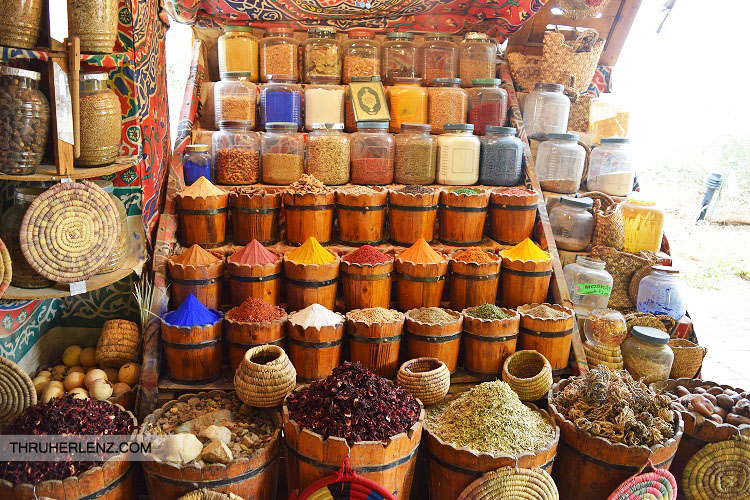 Stand selling fresh herbs and spices on the streets of Aswan.