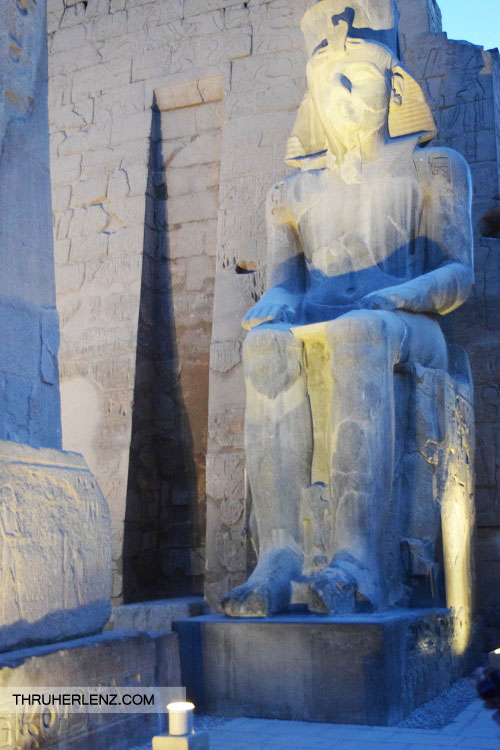 Luxor Temple sculpture lit up at night